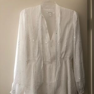 White long sleeve dress with silver dashes.